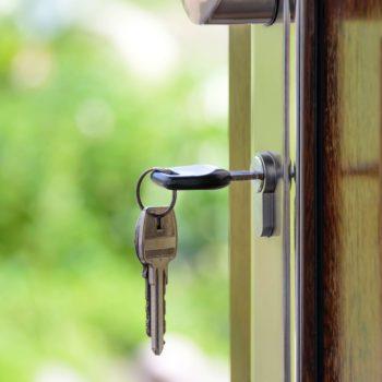house keys in front door lock